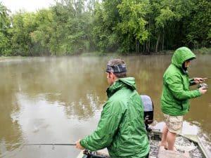 2 anglers with rain gear on bass fishing in the rain